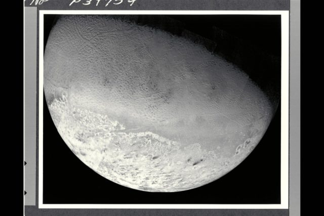 This photomosaic of Triton, assembled from 14 individual frames, shows the great variety of its surface features.  At the bottom of the image are remnants of the south polar cap, containing 'dark'  streaks generally aligned towards the northeast (upper right in the image).  Even though these are darker than other features on Triton, they reflect nearly ten times as much light as the surface of the Earth's moon.  North of the cap, in the western (left) half of the disk is the region which has been informally dubbed the 'cantaloupe' terrain.  Small dimples with upraised rims and shallow central depressions dot the area.  Long fractures have opened allowing some icy material to ooze up and form a central ridge.  These criss-cross the region and extend into parts of the polar cap region.  Towards the south this terrain has a light covering of frost.  Running east to the limb of Triton, just north of the polar cap, is an area of smooth plains and low hills which is the most densely cratered region seen.  In the northeast (upper right) of this image are plains which show evidence for extensive resurfacing, including possible extrusions of flowing material onto the surface.  This region also contains two large smooth areas reminiscent of the maria of the Earth's moon which were formed by large-scale volcanic flooding.  Near the eastern (right) limb of Triton are three darker gray markings with sharply defined brighter borders.  These are unlike anything else seen in the solar system, and their origin is not yet understood. ARC-1989-A89-7061
