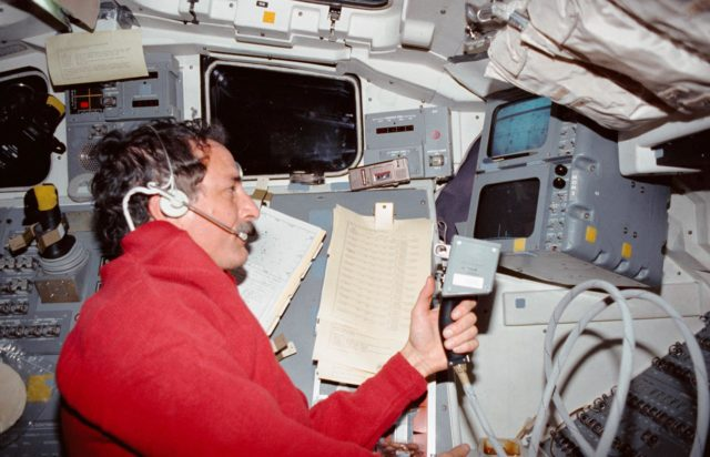 STS-35 MS Hoffman operates ASTRO-1 MPC on OV-102's aft flight deck