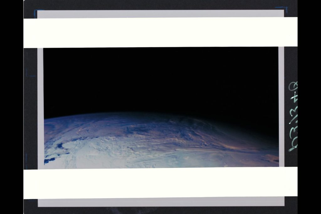 This color picture of the limb of the Earth, looking north past Antarctica, is a mosaic of 11 images taken during a ten-minute period near 5:45 p.m. PST Dec. 8, 1990, by Galileo's imaging system.  Red, green and violet filters were used.  The picture spans about 1,600 miles across the south polar latitudes of our planet  The morning day/night terminator is toward the right.  The South Pole is out of sight below the picture;  the visible areas of Antarctica are those lying generally south of South America.  The violet-blue envelope of Earth's atmosphere is prominent along the limb to the left.  At lower left, the dark blue Amundsen Sea lies to the left of the Walgreen and Bakutis Coasts.  Beyond it,  Peter Island reacts with the winds to produce a striking pattern of atmosperic waves. (JPL ref. No. P-37340) ARC-1990-AC91-2017