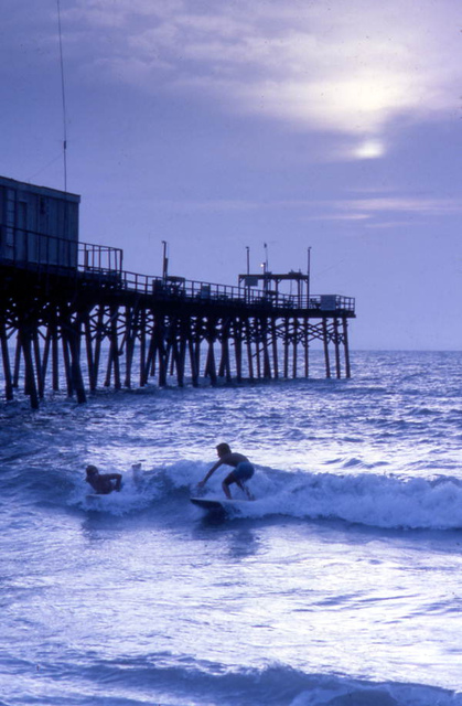 Surfers at the Canaveral Pier in Cocoa Beach