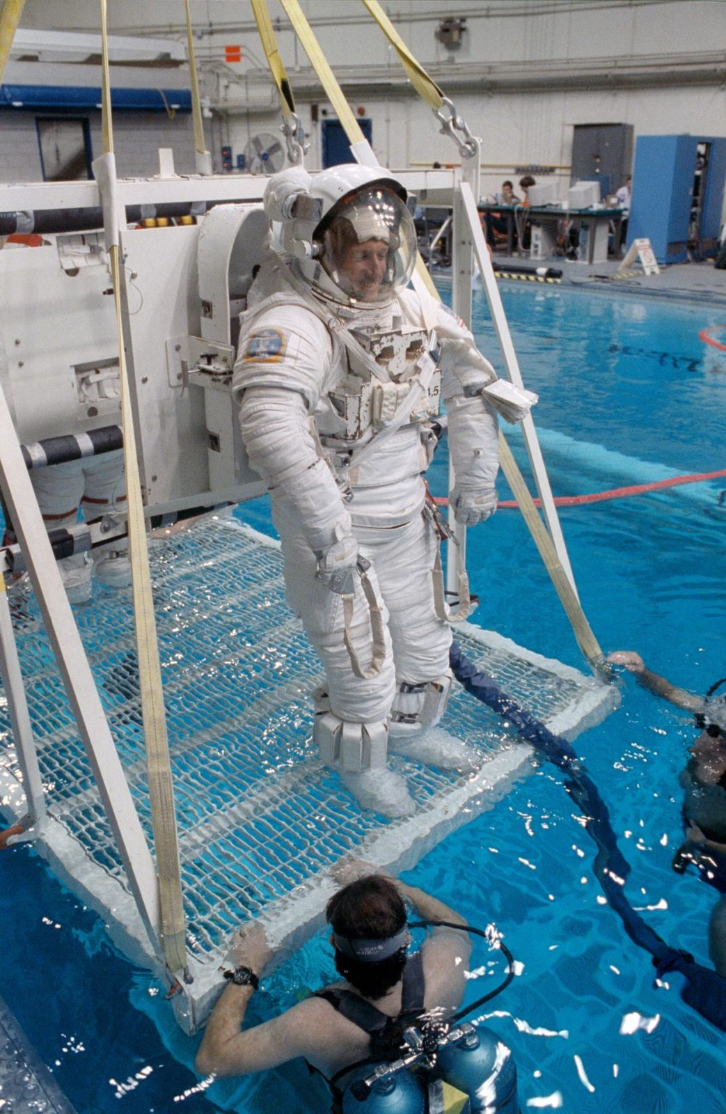 STS 45 MS FOALE IN EMU IS LOWERED INTO JSC S WETF POOL FOR
