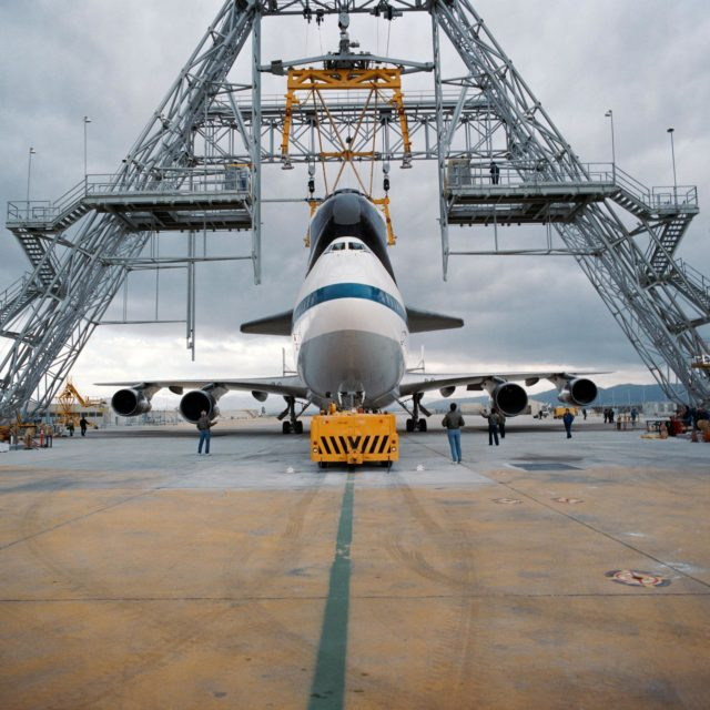 PALMDALE, Calif. -- S91-39477 -- A Rockwell worker at the space shuttle's Palmdale Final Assembly Facility in Palmdale, Calif., takes a technical documentation image of space shuttle Endeavour as it is mated to the agency's Shuttle Carrier Aircraft, or SCA, designated NASA 911, in preparation for its first ferry flight to NASA's Kennedy Space Center in Florida.       Endeavour is scheduled to return to California in 2012, where it will be on public display at the California Science Center in Los Angeles. Its ferry flight across America is targeted for mid-September. Endeavour was the last space shuttle added to NASA's orbiter fleet. During the course of its 19-year career, Endeavour spent 299 days in space during 25 missions. For more information on shuttle transition and retirement work, visit http://www.nasa.gov/transition. Photo credit: NASA/ Rockwell International Space Systems Division KSC-2012-4807