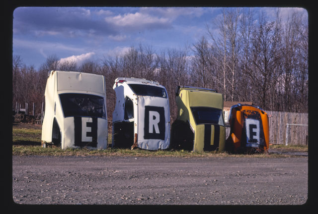 Erie Foreign Car Parts multi-statue sign, angle 1, Mohawk Street, Whitesboro, New York (LOC)