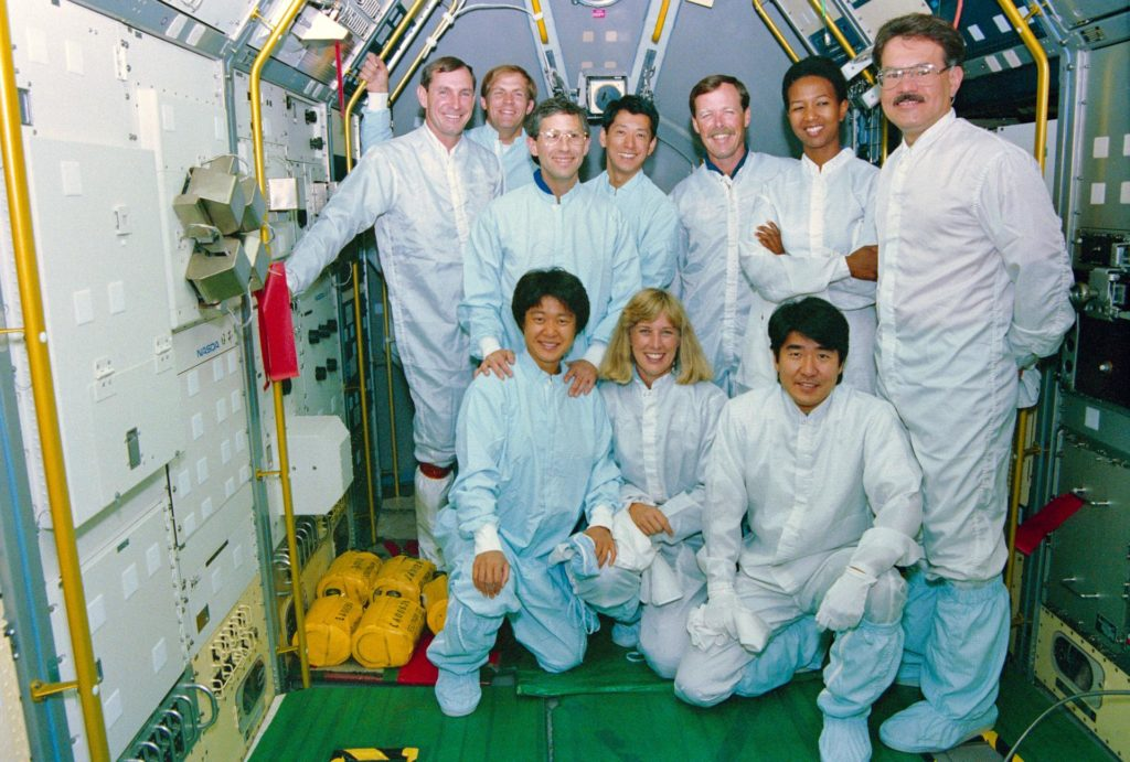 STS-47 crew & backups pose for portrait in SLJ module at KSC during training