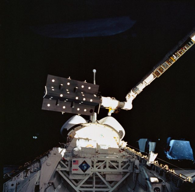 STS-52 CANEX-2 Canadian Target Assembly (CTA) held by RMS over OV-102's PLB