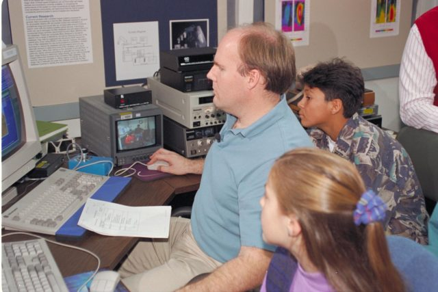 Life from other Worlds' with McNair Middle School TROV robot explores under Antarctic ice - image of Bob Hines, AMES Scientist, with Students ARC-1993-AC93-0608-29
