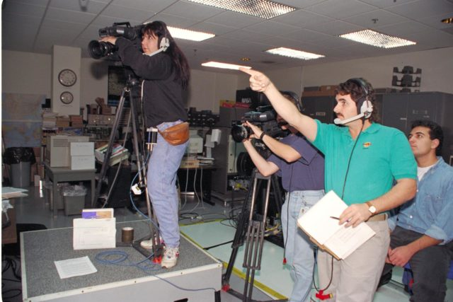 'Life from other Worlds' with McNair Middle School TROV robot explores under Antarctic ice - image shows Eric James and Michelle Bowers video taping ARC-1993-AC93-0608-51