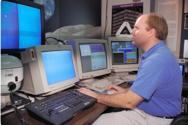 'Life from other Worlds' with McNair Middle School TROV robot explores under Antarctic ice - image of Bob Hines controlling the TROV ARC-1993-AC93-0608-60