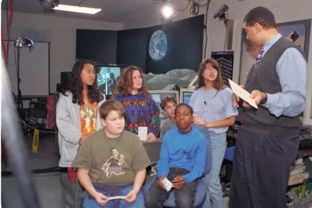 'Life from other Worlds' with McNair Middle School TROV robot explores under Antarctic ice - image of Don James with McNair kids ARC-1993-AC93-0608-65