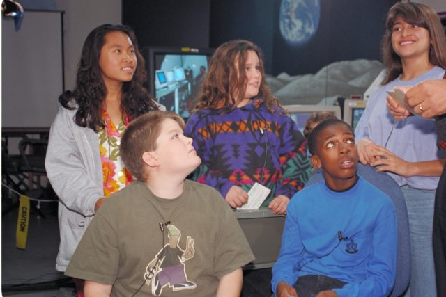 'Life from other Worlds' with McNair Middle School TROV robot explores under Antarctic ice - image of Don James with McNair kids ARC-1993-AC93-0608-66
