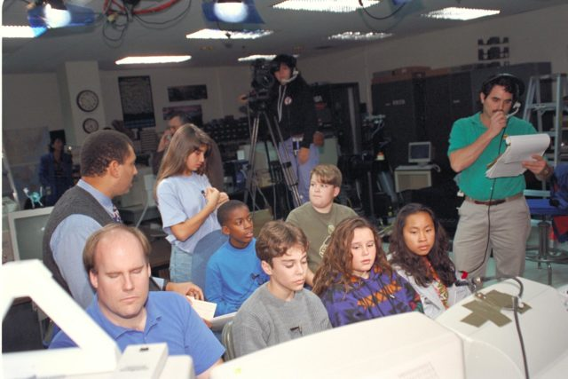 'Life from other Worlds' with McNair Middle School TROV robot explores under Antarctic ice - image during demo with students, Don James and Bob Hines. ARC-1993-AC93-0608-72
