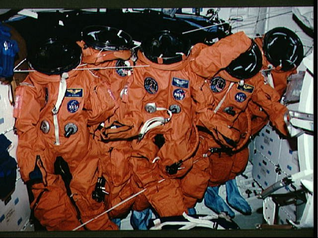 STS-51 orange launch/entry garments aligned on middeck prior to landing