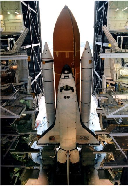KENNEDY SPACE CENTER, FLA. -  After leaving the Vehicle Assembly Building, the Space Shuttle Discovery makes its slow - up to 1 mile per hour - trek along the crawlerway to Launch Pad 39A in preparation for the STS-82 mission.  The Shuttle is assembled on a Mobile Launcher Platform, seen in this view taken from above, and the entire assemblage is carried out to the launch pad on the crawler transporter, which is underneath the MLP.  A seven-member crew will perform the second servicing of the orbiting Hubble Space Telescope (HST) during the 10-day STS-82 mission, which is targeted for a Feb. 11 liftoff.