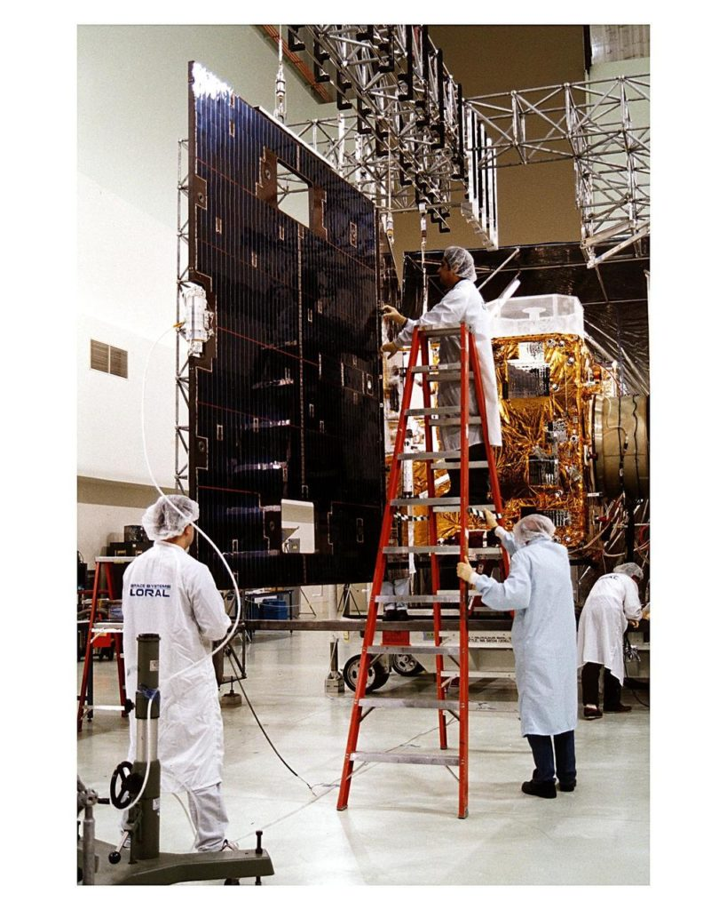 Space Systems/LORAL employees inspect solar panels for the GOES-K weather satellite in the Astrotech facility at Titusville, Fla., as they begin final testing of the imaging system, communications and power systems of the spacecraft. The GOES-K is the third spacecraft to be launched in the new advanced series of geostationary weather satellites for the National Oceanic and Atmospheric Administration (NOAA). The GOES-K is built for NASA and NOAA by Space Systems/LORAL of Palo Alto, Calif. The launch of the satellite from Launch Pad 36B at Cape Canaveral Air Station on an Atlas 1 rocket (AC-79) is currently planned for Apr. 24 at the opening of a launch window which extends from 1:56 to 3:19 a.m. EDT KSC-97pc224
