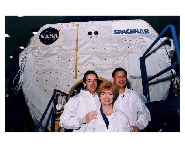 STS-84 crew members pose outside the SPACEHAB Double Module, which will carry more than 6,000 pounds of scientific experiments and logistics to the Russian Space Station Mir. From left, are Mission Specialists Jean-Francois Clervoy of the European Space Agency, Elena V. Kondakova of the Russian Space Agency, and Edward Tsang Lu of NASA. They are participating in the Crew Equipment Integration Test (CEIT) at the SPACEHAB Payload Processing Facility in Cape Canaveral. STS-84 will be the sixth docking of the Space Shuttle with Mir. It also will be the third consecutive crew member exchange of U.S. astronauts aboard Mir. STS-84 Mission Specialist C. Michael Foale will replace astronaut Jerry M. Linenger on Mir. Linenger has been on Mir since the STS-81 mission in January. Foale is scheduled to remain on Mir about four months. STS-84 is targeted for a May 15 liftoff KSC-97pc499