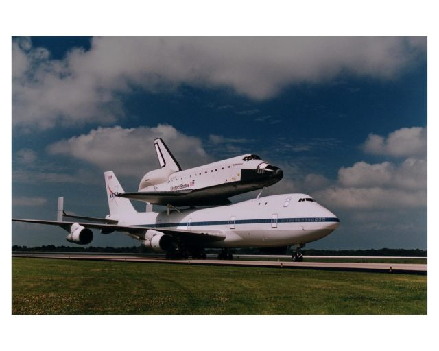 The orbiter Endeavour, riding atop the 747 Shuttle Carrier Aircraft (SCA), landed at KSC's Shuttle Landing Facility at about 9:44 a.m. today, completing is cross-country ferry flight from Palmdale, CA. Endeavour departed Palmdale at about 9 a.m. EST March 26 and stopped briefly for fuel at Ft. Worth Naval Air Station, TX. The vehicle then proceeded to Warner Robbins Air Force Base, GA, where it stayed overnight last night before departing for KSC this morning. Endeavour will be removed from the SCA today and transported to Orbiter Processing Facility bay 1 early tomorrow morning KSC-97pc550