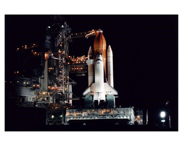 The Space Shuttle Columbia stands poised in the night for the STS-83 Microgravity Science Laboratory-1 (MSL-1) mission after the Rotating Service Structure of Launch Pad 39A has been moved back prior to the start of fueling operations that take place about 12 hours before liftoff. During the scheduled 16-day STS-83 mission, the MSL-1 will be used to test some of the hardware, facilities and procedures that are planned for use on the International Space Station as well as research in combustion, protein crystal growth and materials processing experiments KSC-97pc569