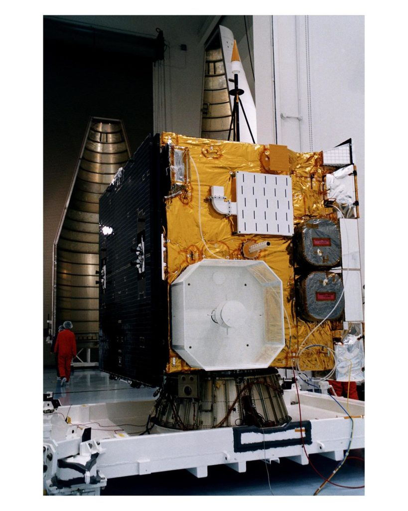 """With its prelaunch processing completed, the GOES-K advanced weather satellite awaits encapsulation in the Atlas 1 payload fairing, seen at left rear. GOES-K was prepared for launch at the Astrotech Space Operations LP facility in Titusville. GOES-K will be the third spacecraft to be launched in the advanced series of Geostationary Operational Environmental Satellites (GOES). The GOES satellites are owned and operated by the National Oceanic and Atmospheric Administration (NOAA); NASA manages the design, development and launch of the spacecraft. GOES-K is targeted for an <a href=""""http://www-pao.ksc.nasa.gov/kscpao/release/1997/63-97.htm"""">April 24 launch</a> aboard a Lockheed Martin Atlas 1 expendable launch vehicle (AC-79) from Launch Complex 36, Pad B, Cape Canaveral Air Station. The launch window opens at 1:50 a.m. and extends to 3:09 a.m. EDT. Once in orbit, GOES-K will become GOES-10, joining GOES-8 and GOES-9 in space KSC-97pc635"""