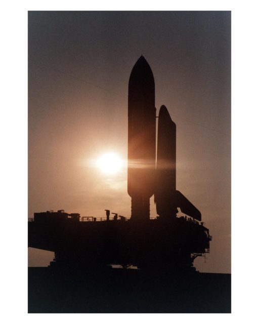 KENNEDY SPACE CENTER, Fla. --  Cast in silhouette by the rising sun, the Space Shuttle Atlantis slowly and carefully makes the journey along the Crawlerway between the Vehicle Assembly Building and Launch Pad 39A. Atlantis and its crew of seven are targeted for a May 15 launch. STS-84 will be the sixth Shuttle docking with the Russian Space Station Mir as part of Phase 1 of the International Space Station program KSC-97pc710