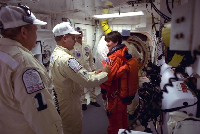 STS-94 Payload Commander Janice Voss prepares to enter the Space Shuttle Columbia at Launch Pad 39A in preparation for launch.  She has flown on STS-83, STS-63 and STS-57. Voss holds a  doctorate degree in aeronautics/astronautics from the Massachusetts Institute of  Technology and has earned two NASA Space Flight Medals. As Payload Commander and  a member of the Blue team, Voss will have overall responsibility for the operation of  all  of the  MSL-1  experiments. During the experimentation phase of the mission, she be  working primarily with three combustion experiments. She and six fellow crew members  will lift off  during a launch window that opens at 1:50 p.m. EDT,  July 1. The launch window will open 47 minutes early to improve the opportunity to  lift off before Florida summer rain showers reach the space center KSC-97PC970