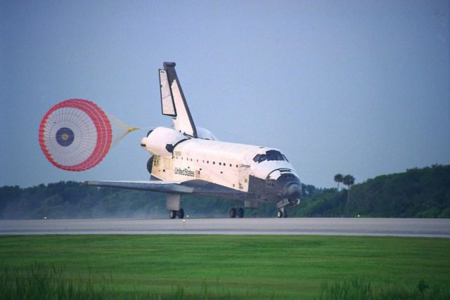 KENNEDY SPACE CENTER, FLA. -- With its drag chute deployed, the Space Shuttle  Orbiter Columbia touches down on Runway 33 at KSC's Shuttle Landing Facility at  6:46:34 a.m. EDT  with Mission Commander  James D. Halsell Jr. and Pilot Susan L.  Still at the controls to complete the STS-94 mission. Also on board are Mission Specialist  Donald A. Thomas, Mission Specialist Michael L. Gernhardt , Payload Commander  Janice Voss, and Payload Specialists Roger  K.  Crouch and Gregory T. Linteris. Mission  elapsed time for STS-94 was 15 days,16 hours, 44 seconds. During the Microgravity  Science Laboratory-1 (MSL-1) mission, the Spacelab module was used to test some of the  hardware, facilities and procedures that are planned for use on the International Space  Station while the flight crew conducted combustion, protein crystal growth and materials  processing experiments. This mission was a reflight of  the STS-83 mission that lifted off   from KSC in April of this year. That space flight was cut short due to indications of a  faulty fuel cell. This was Columbia's 11th landing at KSC and the 38th landing at the  space center in the history of the Shuttle program KSC-97PC1045