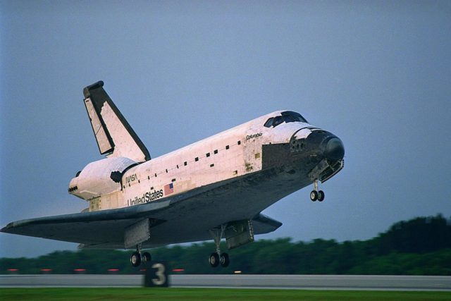 KENNEDY SPACE CENTER, FLA. -- The Space Shuttle orbiter Columbia touches  down on Runway 33 at KSC's Shuttle Landing Facility at 6:46:34 a.m. EDT with  Mission Commander  James D. Halsell Jr. and Pilot Susan L. Still at the controls to  complete the STS-94 mission. Also on board are Mission Specialist Donald A. Thomas,  Mission Specialist Michael L. Gernhardt, Payload Commander Janice Voss, and Payload  Specialists Roger K. Crouch and Gregory T. Linteris. During the Microgravity Science  Laboratory-1 (MSL-1) mission, the Spacelab module was used to test some of the  hardware, facilities and procedures that are planned for use on the International Space  Station while the flight crew conducted combustion, protein crystal growth and materials  processing experiments. This mission was a reflight of  the STS-83 mission that lifted off   from KSC in April of this year. That space flight was cut short due to indications of a  faulty fuel cell. This was Columbia's 11th landing at KSC and the 38th landing at the  space center in the history of the Shuttle program KSC-97PC1046