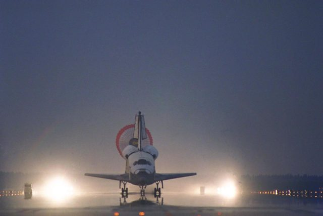 KENNEDY SPACE CENTER, FLA. -- With its drag chute deployed, the Space Shuttle  Orbiter Columbia touches down on Runway 33 at KSC's Shuttle Landing Facility at  6:46:34 a.m. EDT  with Mission Commander  James D. Halsell Jr. and Pilot Susan L.  Still at the controls to complete the STS-94 mission. Also on board are Mission Specialist  Donald A. Thomas, Mission Specialist Michael L. Gernhardt , Payload Commander  Janice Voss, and Payload Specialists Roger  K.  Crouch and Gregory T. Linteris. Mission  elapsed time for STS-94 was 15 days,16 hours, 44 seconds. During the Microgravity  Science Laboratory-1 (MSL-1) mission, the Spacelab module was used to test some of the  hardware, facilities and procedures that are planned for use on the International Space  Station while the flight crew conducted combustion, protein crystal growth and materials  processing experiments. This mission was a reflight of  the STS-83 mission that lifted off   from KSC in April of this year. That space flight was cut short due to indications of a  faulty fuel cell. This was Columbia's 11th landing at KSC and the 38th landing at the  space center in the history of the Shuttle program KSC-97PC1049