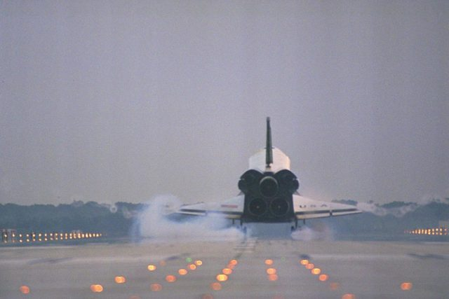 KENNEDY SPACE CENTER, FLA. -- The Space Shuttle orbiter Columbia touches  down on Runway 33 at KSC's Shuttle Landing Facility at 6:46:34 a.m. EDT with  Mission Commander  James D. Halsell Jr. and Pilot Susan L. Still at the controls to  complete the STS-94 mission. Also on board are Mission Specialist Donald A. Thomas,  Mission Specialist Michael L. Gernhardt, Payload Commander Janice Voss, and Payload  Specialists Roger K. Crouch and Gregory T. Linteris. During the Microgravity Science  Laboratory-1 (MSL-1) mission, the Spacelab module was used to test some of the  hardware, facilities and procedures that are planned for use on the International Space  Station while the flight crew conducted combustion, protein crystal growth and materials  processing experiments. This mission was a reflight of  the STS-83 mission that lifted off   from KSC in April of this year. That space flight was cut short due to indications of a  faulty fuel cell. This was Columbia's 11th landing at KSC and the 38th landing at the  space center in the history of the Shuttle program KSC-97PC1050