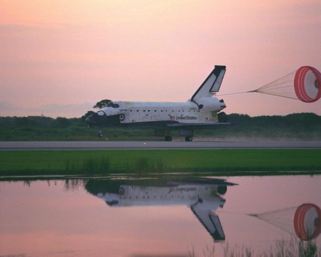 KENNEDY SPACE CENTER, FLA. -- With its drag chute deployed, the Space Shuttle  Orbiter Columbia touches down on Runway 33 at KSC's Shuttle Landing Facility at  6:46:34 a.m. EDT  with Mission Commander  James D. Halsell Jr. and Pilot Susan L.  Still at the controls to complete the STS-94 mission. Also on board are Mission Specialist  Donald A. Thomas, Mission Specialist Michael L. Gernhardt , Payload Commander  Janice Voss, and Payload Specialists Roger  K.  Crouch and Gregory T. Linteris. Mission  elapsed time for STS-94 was 15 days,16 hours, 44 seconds. During the Microgravity  Science Laboratory-1 (MSL-1) mission, the Spacelab module was used to test some of the  hardware, facilities and procedures that are planned for use on the International Space  Station while the flight crew conducted combustion, protein crystal growth and materials  processing experiments. This mission was a reflight of  the STS-83 mission that lifted off   from KSC in April of this year. That space flight was cut short due to indications of a  faulty fuel cell. This was Columbia's 11th landing at KSC and the 38th landing at the  space center in the history of the Shuttle program KSC-97PC1051