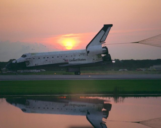 KENNEDY SPACE CENTER, FLA. -- With its drag chute deployed, the Space Shuttle  Orbiter Columbia touches down on Runway 33 at KSC's Shuttle Landing Facility at  6:46:34 a.m. EDT  with Mission Commander  James D. Halsell Jr. and Pilot Susan L.  Still at the controls to complete the STS-94 mission. Also on board are Mission Specialist  Donald A. Thomas, Mission Specialist Michael L. Gernhardt , Payload Commander  Janice Voss, and Payload Specialists Roger  K.  Crouch and Gregory T. Linteris. Mission  elapsed time for STS-94 was 15 days,16 hours, 44 seconds. During the Microgravity  Science Laboratory-1 (MSL-1) mission, the Spacelab module was used to test some of the  hardware, facilities and procedures that are planned for use on the International Space  Station while the flight crew conducted combustion, protein crystal growth and materials  processing experiments. This mission was a reflight of  the STS-83 mission that lifted off   from KSC in April of this year. That space flight was cut short due to indications of a  faulty fuel cell. This was Columbia's 11th landing at KSC and the 38th landing at the  space center in the history of the Shuttle program KSC-97PC1052