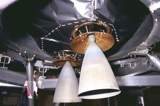 The main engine thruster nozzles of the Cassini  spacecraft have their covers removed prior to the securing of the craft to its launch  vehicle adapter in KSC's Payload Hazardous Servicing Facility. The main engines of  Cassini will be used for Deep Space Maneuver burns, which will be performed  periodically throughout its cruise to Saturn to keep the spacecraft on the correct  trajectory. Large maneuvers (such as a change in spacecraft speed of about one meter per  second or higher) will be done with the main engine, whereas smaller maneuvers will be  performed by the thrusters and/or reaction wheels. Scheduled for launch in October, the  Cassini mission seeks insight into the origins and evolution of the early solar system. It  will take seven years for the spacecraft to reach Saturn KSC-97PC1107