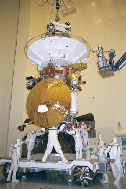 Flight mechanics from NASA's Jet Propulsion  Laboratory (JPL) in Pasadena, Calif., secure the Cassini spacecraft to its launch vehicle  adapter in KSC's  Payload Hazardous Servicing Facility. The adapter will later be mated  to a Titan IV/Centaur expendable launch vehicle that will lift Cassini into space. The  mechanic in the crane lift at right is assisting in exact positioning of the spacecraft for  precise fitting. Scheduled for launch in October, the Cassini mission seeks insight into the  origins and evolution of the early solar system. Scientific instruments carried aboard the  spacecraft will study Saturn's atmosphere, magnetic field, rings, and several moons. JPL  is managing the Cassini project for NASA KSC-97PC1111