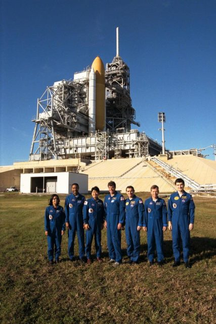 The crew of the STS-87 mission, scheduled for launch Nov. 19 aboard the Space Shuttle Columbia from Pad 39B at Kennedy Space Center (KSC), participate in the Terminal Countdown Demonstration Test (TCDT) at KSC. Posing for a group shot by Pad 39B are, from left to right, Mission Specialist Kalpana Chawla, Ph.D.; Mission Specialist Winston Scott; Mission Specialist Takao Doi, Ph.D., of the National Space Development Agency of Japan; Commander Kevin Kregel; Payload Specialist Leonid Kadenyuk of the National Space Agency of Ukraine (NSAU); Pilot Steven Lindsey; and Kadenyuk's back-up, Yaroslav Pustovyi, Ph.D., also of NSAU. The TCDT is held at KSC prior to each Space Shuttle flight, providing the crew of each mission opportunities to participate in simulated countdown activities. The crew also spends time undergoing emergency egress training exercises at the pad and has an opportunity to view and inspect the payloads in the orbiter's payload bay KSC-97PC1620