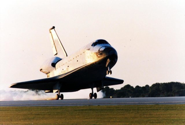 With Commander Kevin Kregel and Pilot Steven Lindsey at the controls, the orbiter Columbia touches its main gear down on Runway 33 at KSC's Shuttle Landing Facility at 7:20:04 a.m. EST Dec. 5 to complete the 15-day, 16-hour and 34-minute-long STS-87 mission of 6.5 million miles. Also onboard the orbiter are Mission Specialists Winston Scott; Kalpana Chawla, Ph.D.; and Takao Doi, Ph.D., of the National Space Development Agency of Japan; along with Payload Specialist Leonid Kadenyuk of the National Space Agency of Ukraine. During the 88th Space Shuttle mission, the crew performed experiments on the United States Microgravity Payload-4 and pollinated plants as part of the Collaborative Ukrainian Experiment. This was the 12th landing for Columbia at KSC and the 41st KSC landing in the history of the Space Shuttle program KSC-97PC1739