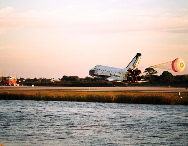 With Commander Kevin Kregel and Pilot Steven Lindsey at the controls, the orbiter Columbia, with its drag chute deployed, touches its main gear down on Runway 33 at KSC's Shuttle Landing Facility at 7:20:04 a.m. EST Dec. 5 to complete the 15-day, 16-hour and 34-minute-long STS-87 mission of 6.5 million miles. Also onboard the orbiter are Mission Specialists Winston Scott; Kalpana Chawla, Ph.D.; and Takao Doi, Ph.D., of the National Space Development Agency of Japan; along with Payload Specialist Leonid Kadenyuk of the National Space Agency of Ukraine. During the 88th Space Shuttle mission, the crew performed experiments on the United States Microgravity Payload-4 and pollinated plants as part of the Collaborative Ukrainian Experiment. This was the 12th landing for Columbia at KSC and the 41st KSC landing in the history of the Space Shuttle program KSC-97PC1743