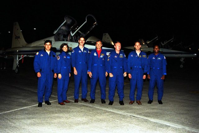 The STS-89 crew pose at Kennedy Space Center's (KSC's) Shuttle Landing Facility after flying in from NASA's Johnson Space Center to begin Terminal Countdown Demonstration Test (TCDT) activities. The TCDT is held at KSC prior to each Space Shuttle flight to provide crews with the opportunity to participate in simulated countdown activities. Endeavour is targeted for launch of STS-89 on Jan. 22 at 9:48 p.m. EST. From left to right are Mission Specialists Salizhan Sharipov, of the Russian Space Agency, Bonnie Dunbar, Ph.D., and James Reilly, Ph.D.; Commander Terrence Wilcutt; Mission Specialist Andrew Thomas, Ph.D.; Pilot Joe Edwards Jr.; and Mission Specialist Michael Anderson. Mission STS-89 will be the first mission of 1998 and the eighth to dock with Russia's Mir Space Station, where Thomas will succeed David Wolf, M.D., who has been on Mir since September 28. The STS-89 mission is scheduled to last nine days KSC-98pc114