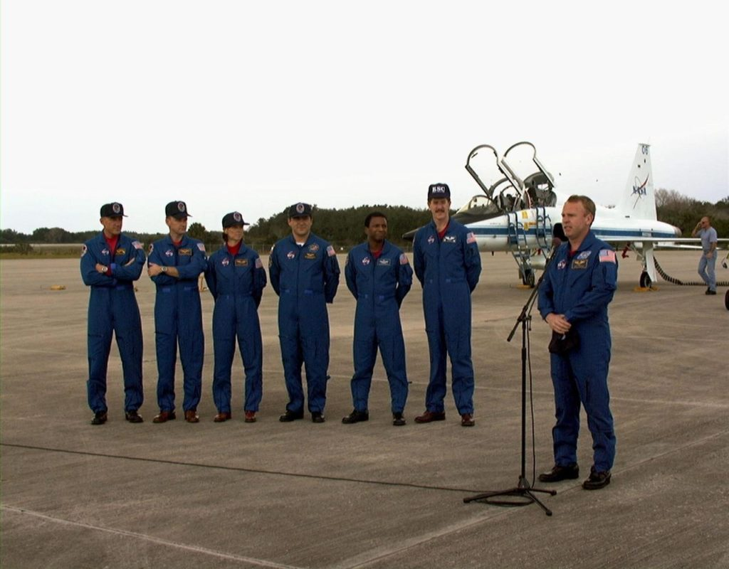 The STS-89 crew speak with the press after arriving at Kennedy Space Center's Shuttle Landing Facility in preparation for launch later this week. From left to right the crew include Commander Terrence Wilcutt; Pilot Joe Edwards Jr.; and Mission Specialists Bonnie Dunbar, Ph.D.; Salizhan Sharipov with the Russian Space Agency; Michael Anderson; James Reilly, Ph.D.; and Andrew Thomas, Ph.D. (at microphone). Dr. Thomas will succeed David Wolf, M.D., on the Russian Space Station Mir. Launch is scheduled for January 22 at 9:48 p.m. EST KSC-sts8907