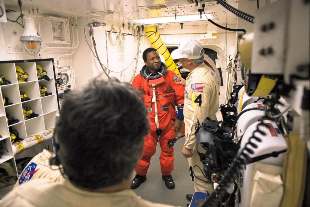 STS-89 Mission Specialist Michael Anderson is assisted with his ascent and re-entry flight suit in the white room at Launch Pad 39A before entering Space Shuttle Endeavour for launch. The STS-89 mission will be the eighth docking of the Space Shuttle with the Russian Space Station Mir. After docking, Mission Specialist Andrew Thomas, Ph.D., will transfer to the space station, succeeding David Wolf, M.D., who will return to Earth aboard Endeavour. Dr. Thomas will live and work on Mir until June. STS-89 is scheduled for a Jan. 22 liftoff at 9:48 p.m KSC-98pc230