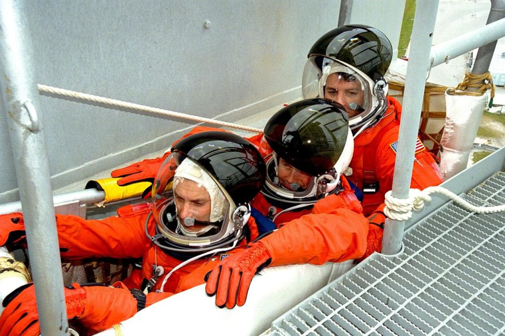 Members of the STS-90 crew participate in mock emergency egress activities during the Terminal Countdown Demonstration Test (TCDT) at KSC's Launch Pad 39B. The TCDT is held at KSC prior to each Space Shuttle flight to provide crews with the opportunity to participate in simulated countdown activities. The STS-90 crew members shown here are, front to back, Payload Specialists James Pawelczyk, Ph.D., and Jay Buckey, M.D., and Mission Specialist Richard Linnehan, D.V.M. Columbia is targeted for launch of STS-90 on April 16 at 2:19 p.m. EDT and will be the second mission of 1998. The mission is scheduled to last nearly 17 days KSC-98pc452