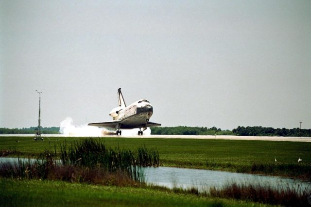 The orbiter Columbia touches down on Runway 33 of KSC's Shuttle Landing Facility to complete the nearly 16-day STS-90 mission. Main gear touchdown was at 12:08:59 p.m. EDT on May 3, 1998, landing on orbit 256 of the mission. The wheels stopped at 12:09:58 EDT, completing a total mission time of 15 days, 21 hours, 50 minutes and 58 seconds. The 90th Shuttle mission was Columbia's 13th landing at the space center and the 43rd KSC landing in the history of the Space Shuttle program. During the mission, the crew conducted research to contribute to a better understanding of the human nervous system. The crew of the STS-90 Neurolab mission include Commander Richard Searfoss; Pilot Scott Altman; Mission Specialists Richard Linnehan, D.V.M., Dafydd (Dave) Williams, M.D., with the Canadian Space Agency, and Kathryn (Kay) Hire; and Payload Specialists Jay Buckey, M.D., and James Pawelczyk, Ph.D KSC-98pc554