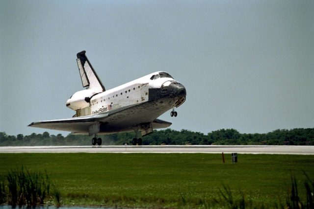 The orbiter Columbia approaches touchdown on Runway 33 of KSC's Shuttle Landing Facility to complete the nearly 16-day STS-90 mission. Main gear touchdown was at 12:08:59 p.m. EDT on May 3, 1998, landing on orbit 256 of the mission. The wheels stopped at 12:09:58 EDT, completing a total mission time of 15 days, 21 hours, 50 minutes and 58 seconds. The 90th Shuttle mission was Columbia's 13th landing at the space center and the 43rd KSC landing in the history of the Space Shuttle program. During the mission, the crew conducted research to contribute to a better understanding of the human nervous system. The crew of the STS-90 Neurolab mission include Commander Richard Searfoss; Pilot Scott Altman; Mission Specialists Richard Linnehan, D.V.M., Dafydd (Dave) Williams, M.D., with the Canadian Space Agency, and Kathryn (Kay) Hire; and Payload Specialists Jay Buckey, M.D., and James Pawelczyk, Ph.D KSC-98pc557