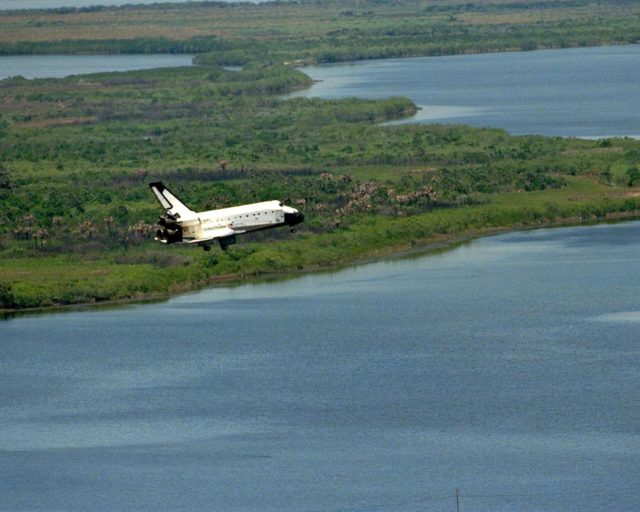 The orbiter Columbia approaches touchdown on Runway 33 of KSC's Shuttle Landing Facility to complete the nearly 16-day STS-90 mission. Framed by Florida foliage and wetlands, this unique view was taken from the roof of the 525-foot-high Vehicle Assembly Building. Main gear touchdown was at 12:08:59 p.m. EDT on May 3, 1998, landing on orbit 256 of the mission. The wheels stopped at 12:09:58 EDT, completing a total mission time of 15 days, 21 hours, 50 minutes and 58 seconds. The 90th Shuttle mission was Columbia's 13th landing at the space center and the 43rd KSC landing in the history of the Space Shuttle program. During the mission, the crew conducted research to contribute to a better understanding of the human nervous system. The crew of the STS-90 Neurolab mission include Commander Richard Searfoss; Pilot Scott Altman; Mission Specialists Richard Linnehan, D.V.M., Dafydd (Dave) Williams, M.D., with the Canadian Space Agency, and Kathryn (Kay) Hire; and Payload Specialists Jay Buckey, M.D., and James Pawelczyk, Ph.D KSC-98pc562