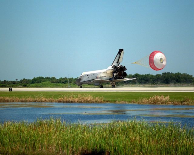 With its drag chute deployed, the orbiter Columbia touches down on Runway 33 of KSC's Shuttle Landing Facility to complete the nearly 16-day STS-90 mission. Main gear touchdown was at 12:08:59 p.m. EDT on May 3, 1998, landing on orbit 256 of the mission. The wheels stopped at 12:09:58 EDT, completing a total mission time of 15 days, 21 hours, 50 minutes and 58 seconds. The 90th Shuttle mission was Columbia's 13th landing at the space center and the 43rd KSC landing in the history of the Space Shuttle program. During the mission, the crew conducted research to contribute to a better understanding of the human nervous system. The crew of the STS-90 Neurolab mission include Commander Richard Searfoss; Pilot Scott Altman; Mission Specialists Richard Linnehan, D.V.M., Dafydd (Dave) Williams, M.D., with the Canadian Space Agency, and Kathryn (Kay) Hire; and Payload Specialists Jay Buckey, M.D., and James Pawelczyk, Ph.D KSC-98pc566