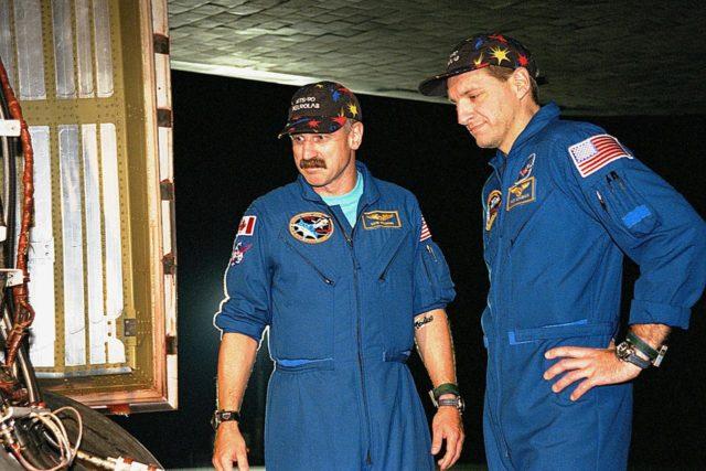 STS-90 Mission Specialists Dafydd (Dave) Williams, M.D., with the Canadian Space Agency (left) and Richard Linnehan, D.V.M., inspect the orbiter Columbia's tires in the evening after their midday arrival on May 3, ending their nearly 16-day Neurolab mission. The 90th Shuttle mission was Columbia's 13th landing at the space center and the 43rd KSC landing in the history of the Space Shuttle program. During the mission, the crew conducted research to contribute to a better understanding of the human nervous system KSC-98pc578