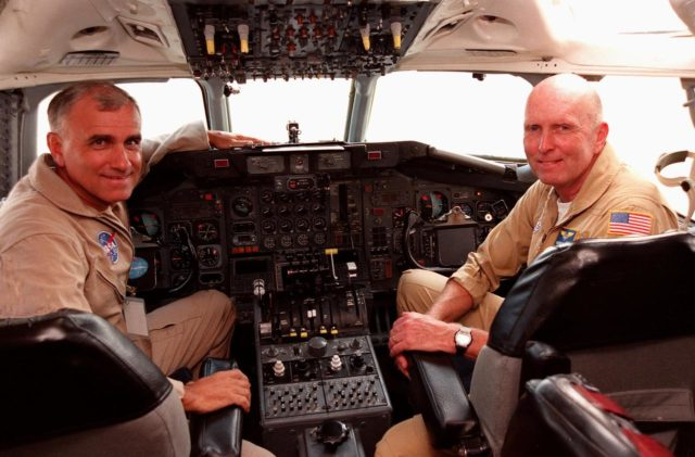 NASA pilots Dick Ewens and Gordon Fullerton sit at the controls in the cockpit of the Dryden Flight Research Center DC-8 that was on view at Patrick Air Force Base. The DC-8 is one of two aircraft being flown in a hurricane study through September to learn about the storms from top to bottom. Flying at 35,000 to 40,000 feet, the DC-8 is equipped with instruments to measure a hurricane's structure, environment and changes in intensity and tracking. The other plane, a modified U2, and the DC-8 will fly in conjunction with scheduled storm flights of the National Oceanic and Atmospheric Administration (NOAA) out of MacDill Air Force Base in Tampa and the U.S. Air Force 53rd Weather Reconnaissance Squadron from Keesler Air Force Base, Miss. The study is part of NASA's Earth Science enterprise to better understand the total Earth system and the effects of natural and human-induced changes on the global environment KSC-98pc911
