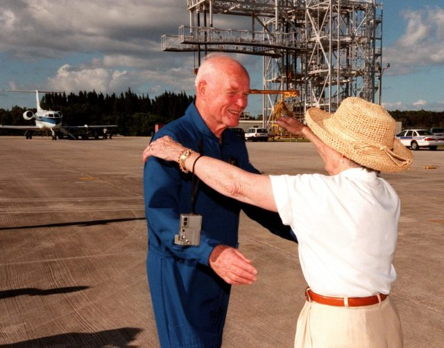 STS-95 Payload Specialist John H. Glenn Jr., senator from Ohio, reaches to embrace his wife, Annie, after landing at Kennedy Space Center's Shuttle Landing Facility aboard a T-38 jet. Behind the couple is the mate/demate device used to raise and lower the orbiter from its shuttle carrier aircraft during ferry operations. Glenn and other crewmembers flew into KSC to make final preparations for launch. Targeted for liftoff at 2 p.m. on Oct. 29, the STS-95 mission includes research payloads such as the Spartan solar-observing deployable spacecraft, the Hubble Space Telescope Orbital Systems Test Platform, the International Extreme Ultraviolet Hitchhiker, as well as the SPACEHAB single module with experiments on space flight and the aging process. The mission is expected to last 8 days, 21 hours and 49 minutes, and return to KSC on Nov. 7. The other STS-95 crew members are Mission Commander Curtis L. Brown Jr., Pilot Steven W. Lindsey, Mission Specialist Scott E. Parazynski, Mission Specialist Stephen K. Robinson, Mission Specialist Pedro Duque, with the European Space Agency (ESA), and Payload Specialist Chiaki Mukai, with the National Space Development Agency of Japan (NASDA) KSC-98pc1398