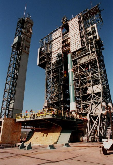 KENNEDY SPACE CENTER, FLA. -- On Pad 17A at Cape Canaveral Air Station, a Delta II rocket is maneuvered into position for launch on Dec. 10, 1998. The rocket is carrying the Mars Climate Orbiter which will head for Mars primarily to support its companion Mars Polar Lander spacecraft, which is planned for launch on Jan. 3, 1999. The orbiter's instruments will monitor the Martian atmosphere and image the planet's surface on a daily basis for one Martian year (1.8 Earth years). It will observe the appearance and movement of atmospheric dust and water vapor, as well as characterize seasonal changes on the surface. The detailed images of the surface features will provide important clues to the planet's early climate history and give scientists more information about possible liquid water reserves beneath the surface KSC-98pc1620