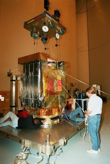 In the Payload Hazardous Service Facility, a worker prepares the Stardust spacecraft for its transfer to . Built by Lockheed Martin Astronautics near Denver, Colo., for the Jet Propulsion Laboratory (JPL) and NASA, the spacecraft Stardust will use a unique medium called aerogel to capture comet particles flying off the nucleus of comet Wild 2 in January 2004, plus collect interstellar dust for later analysis. Stardust will be launched aboard a Boeing Delta 7426 rocket from Complex 17, Cape Canaveral Air Station, targeted for Feb. 6, 1999. . The collected samples will return to Earth in a re-entry capsule to be jettisoned from Stardust as it swings by in January 2006 KSC-98pc1632