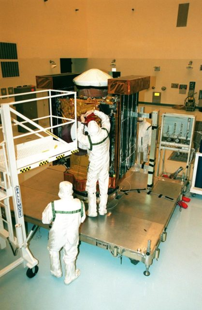 In the Payload Hazardous Service Facility, workers begin checking the Stardust spacecraft after removing its protective cover. The spacecraft will undergo installation and testing of the solar arrays, plus final installation and testing of spacecraft instruments followed by an overall spacecraft functional test. Built by Lockheed Martin Astronautics near Denver, Colo., for the Jet Propulsion Laboratory (JPL) and NASA, the spacecraft Stardust will use a unique medium called aerogel to capture comet particles flying off the nucleus of comet Wild 2 in January 2004, plus collect interstellar dust for later analysis. Stardust will be launched aboard a Boeing Delta 7426 rocket from Complex 17, Cape Canaveral Air Station, targeted for Feb. 6, 1999. The collected samples will return to Earth in a re-entry capsule to be jettisoned from Stardust as it swings by Earth in January 2006 KSC-98pc1637