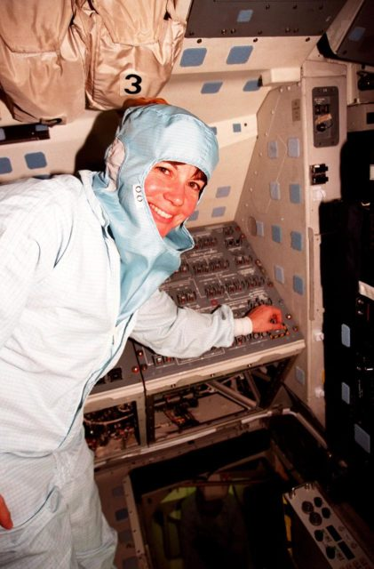 In the Orbiter Processing Facility Bay 3, during the Crew Equipment Interface Test (CEIT), Mission Specialist Catherine G. Coleman checks equipment that will fly on mission STS-93. The STS-93 mission will deploy the Advanced X-ray Astrophysics Facility (AXAF) which comprises three major elements: the spacecraft, the telescope, and the science instrument module (SIM). AXAF will allow scientists from around the world to obtain unprecedented X-ray images of a variety of high-energy objects to help understand the structure and evolution of the universe. The other STS-93 crew members are Mission Commander Eileen M. Collins, Pilot Jeffrey S. Ashby, Mission Specialist Steven A. Hawley and Mission Specialist Michel Tognini of France. Targeted date for the launch of STS-93 is March 18, 1999 KSC-98pc1690